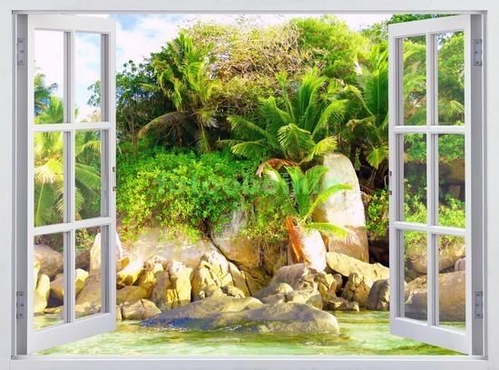 Окно с видом на пляж и камни