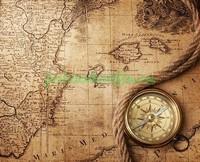 Компас на фоне карты