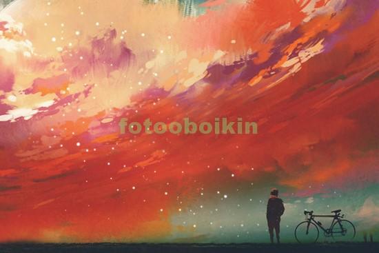Велосипедист смотрит на небо