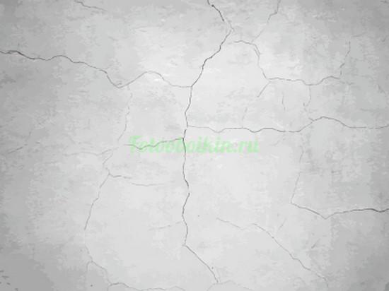 Белая стена с трещинами