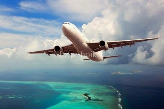 Фотообои Самолет над морем