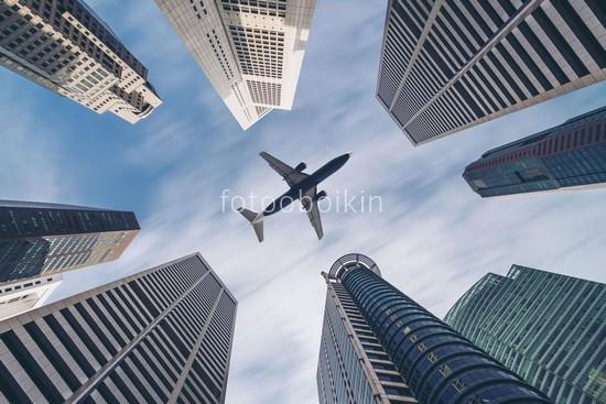Фотообои Самолет над небоскребами