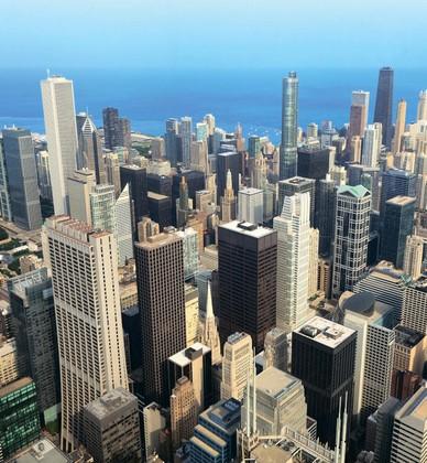 Фотообои Вид с высоты птичьего полета на небоскребы и синее море