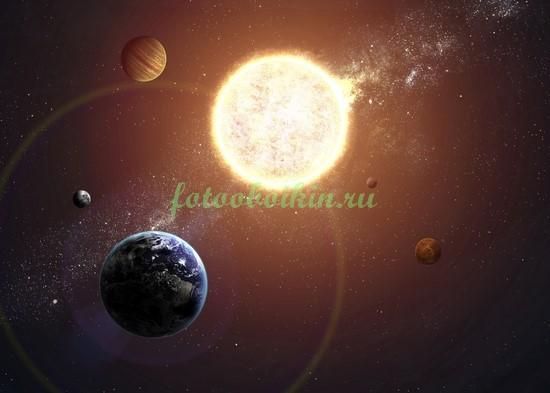Фотообои Земля на фоне солнца